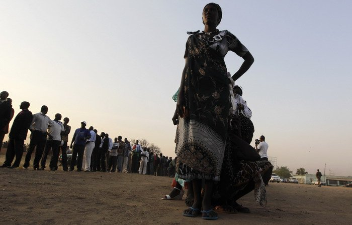 South Sudanese voters queue before casting their ballot during the referendum at the John Garang memorial mausoleum in Juba